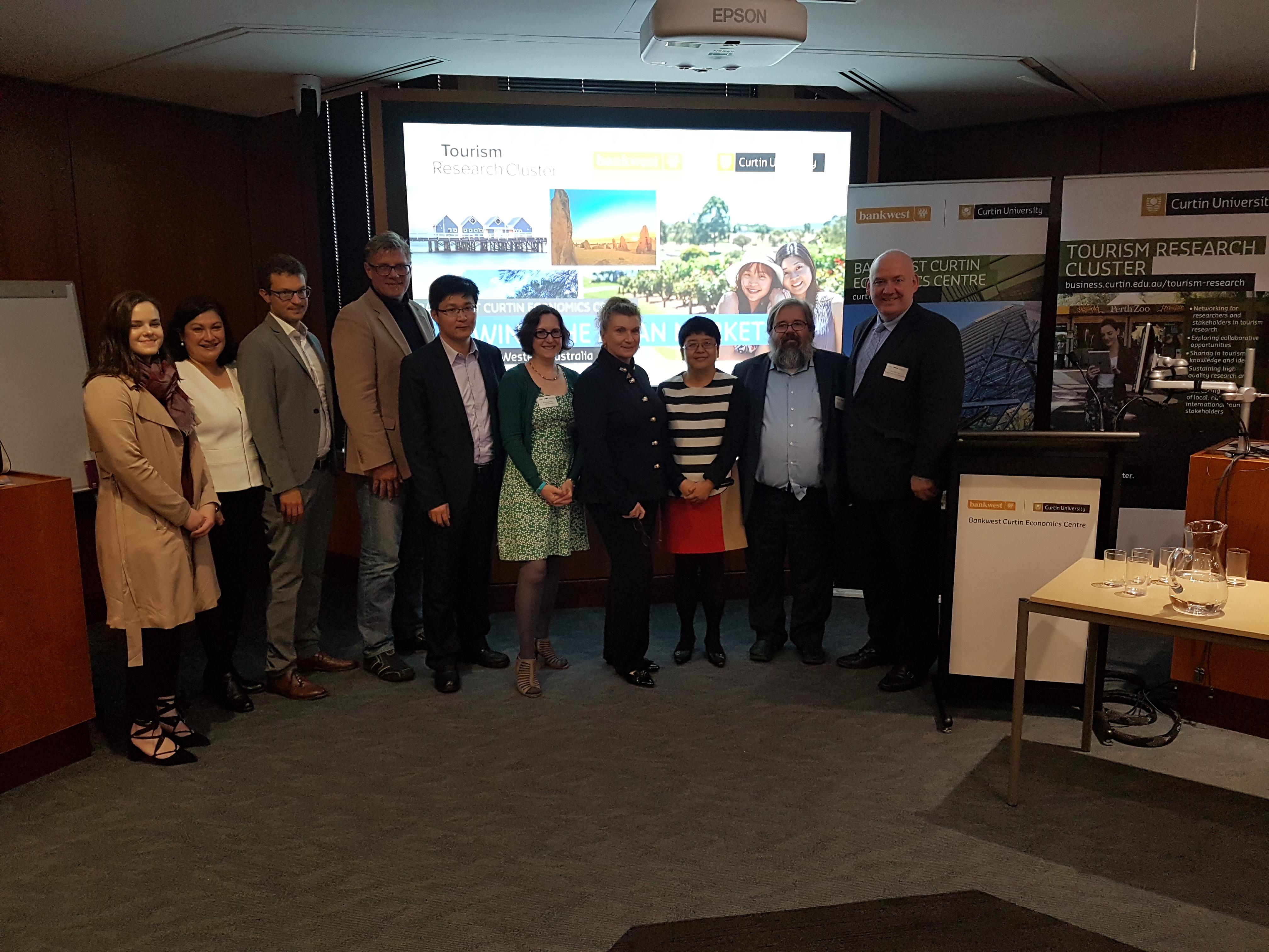 Photo of speakers at Tourism Symposium