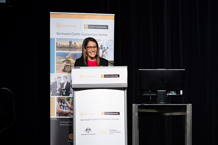 Rebecca Mitchell, Bankwest, standing at a lectern with a BCEC pull up banner behind her